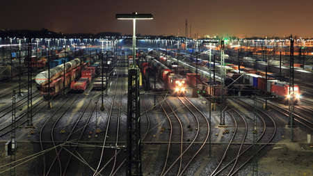Train yard lit up at night