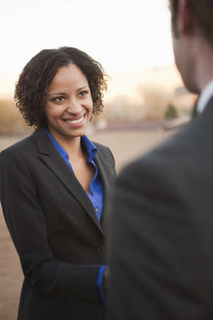 agrees: Woman in suit shaking hands with man