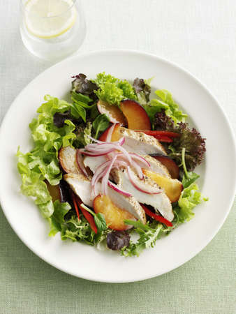 Plate of fish and plum salad LANG_EVOIMAGES
