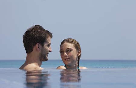 lavishly: Couple relaxing in infinity pool