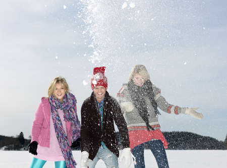 Friend throwing snow LANG_EVOIMAGES