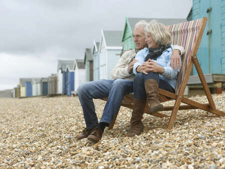 legs around: Seniors together on beach LANG_EVOIMAGES