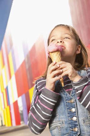 Little girl enjoying ice cream outdoors