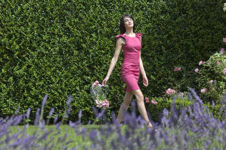 basking: Woman gathering flowers outdoors