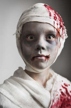 Child dressed as mummy for Halloween LANG_EVOIMAGES