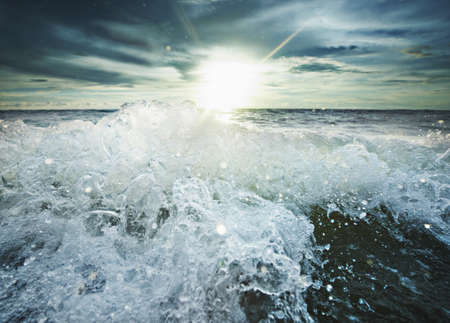 seascapes: Sun shining over rocky waves