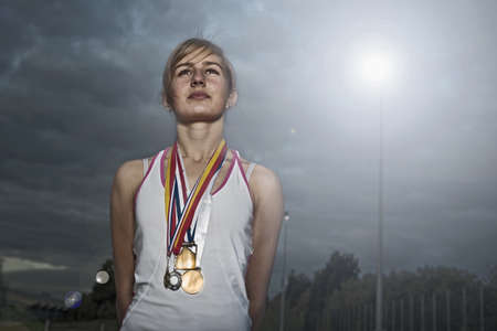 street lamp: Portrait of female athlete with medals LANG_EVOIMAGES