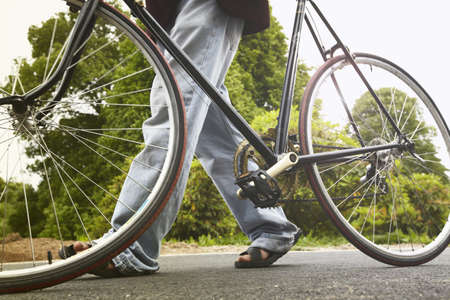 Close up of man walking bicycle