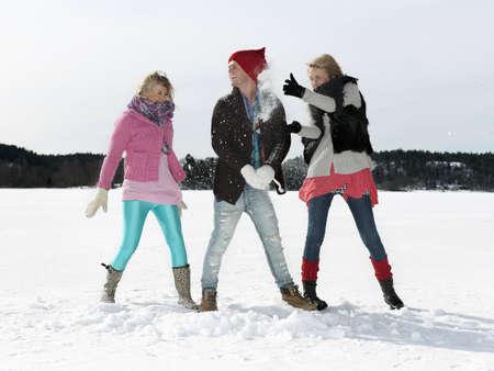 Friends having snow war