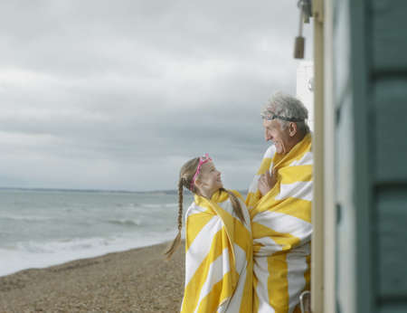 grampa: Grandfather and Granddaughter at beach LANG_EVOIMAGES