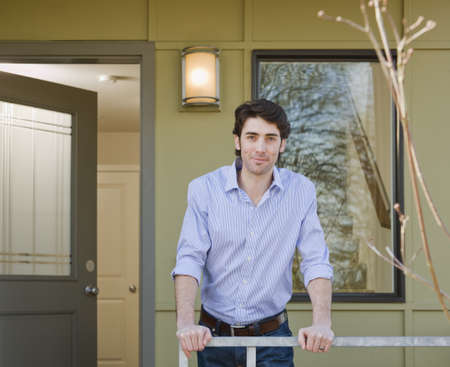 abodes: man on front porch LANG_EVOIMAGES