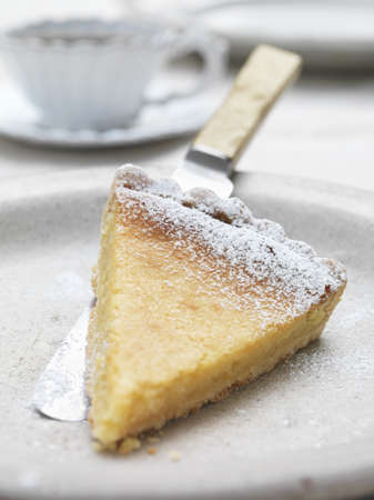 Slice of lemon tart on plate