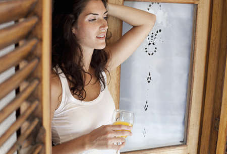 Woman holding a glass with juice LANG_EVOIMAGES