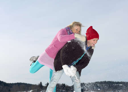 mischeif: Couple having snow war