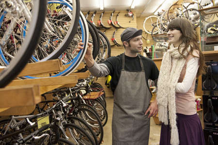 Woman Shopping for Bike in Bike Shop LANG_EVOIMAGES
