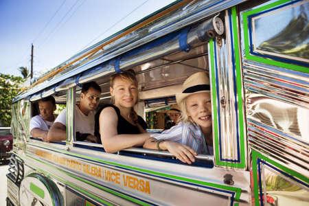 motorcoach: Passengers sitting by bus window