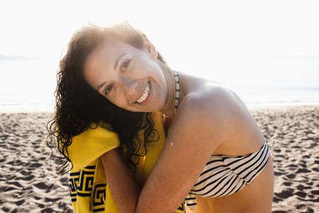 Woman drying her hair on beach