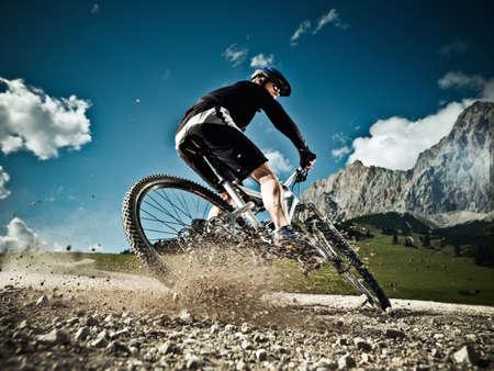 Male mountain biker riding downhill