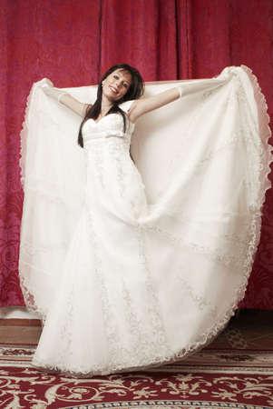 Bride trying wedding dress