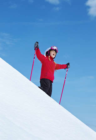 Girl skiing, blue sky