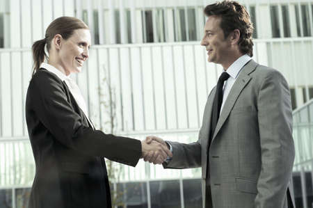 agrees: Business man and woman shaking hands