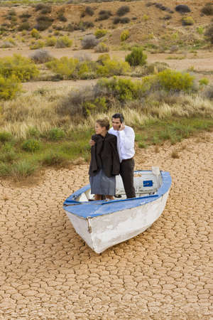 hardships: Business-couple lost in desert