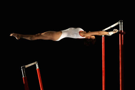 gymnast in between two high bars LANG_EVOIMAGES