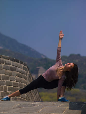 Woman posing on Great Wall of China LANG_EVOIMAGES