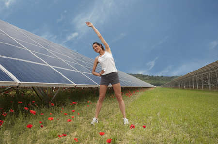 futures: woman stretching along solar panel