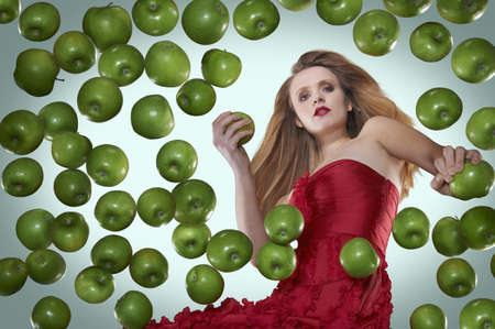 tempted: Woman in evening gown with apples