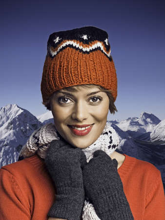 Woman wearing winter gear in snow LANG_EVOIMAGES