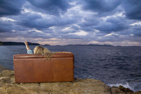 couple on couch look at sea sky LANG_EVOIMAGES