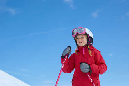 Girl skiing, blue sky