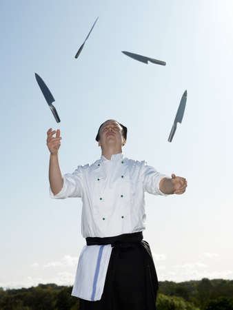 perilous: Chef juggling with knives