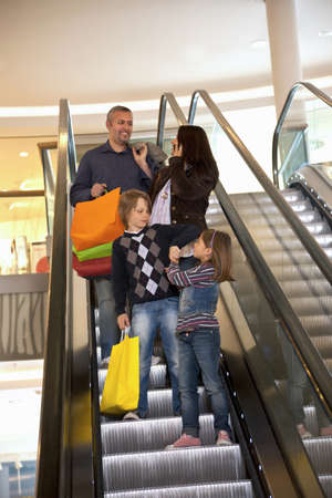 mischeif: Family on an escalator