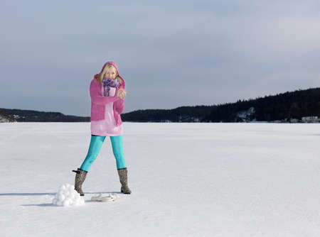 Girl making a snow ball