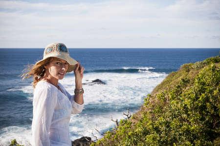 hi hat: Woman standing on coastal cliffs