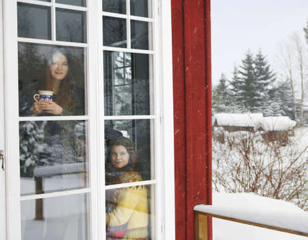 snowed: Two women viewing snow scene