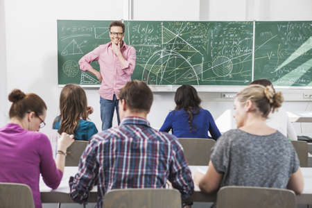 taught man: Teacher addressing students in class