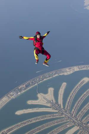 exhilarating: Woman skydiving over rural landscape