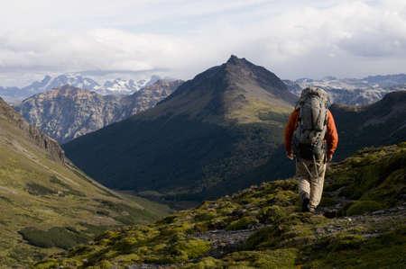 Hiker walking in grassy hills LANG_EVOIMAGES