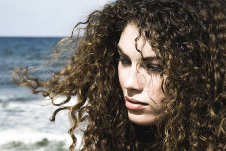 Close up of woman's face on beach