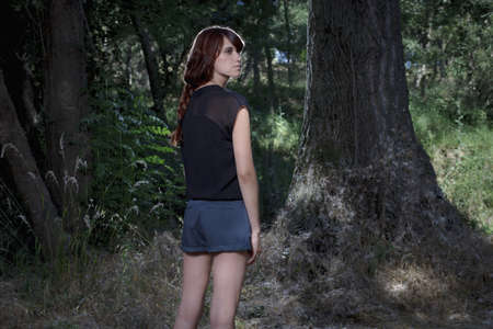 Woman standing in forest LANG_EVOIMAGES