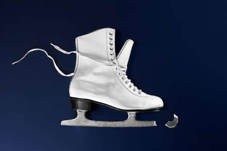 Close up of broken ice skate LANG_EVOIMAGES