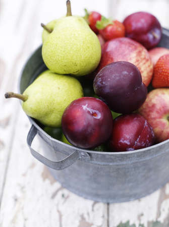 Close up of bucket of fruit