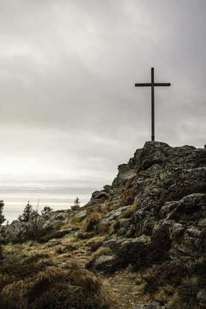 Cross on rocky hilltop
