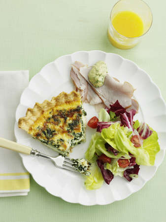 Plate of quiche,ham and salad