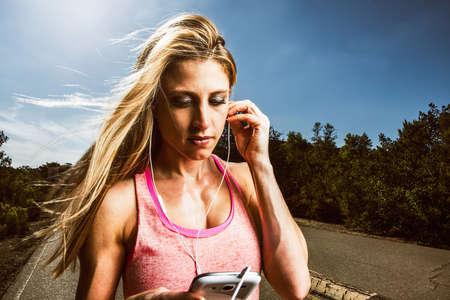 Runner listening to headphones