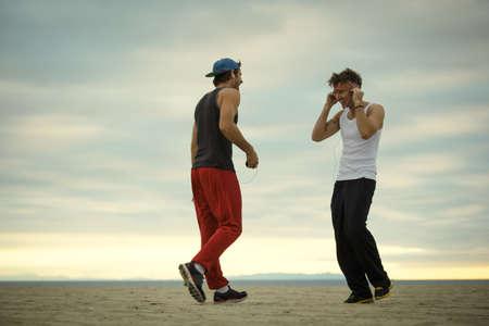 Men talking on beach