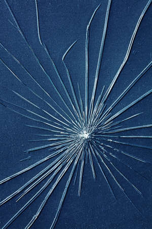 breaking: Close up of cracks in glass